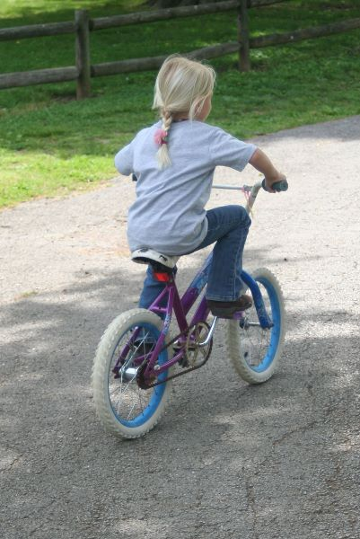 Ruby rides w/out training wheels.